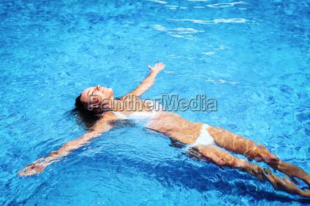 pretty girl in swimming pool
