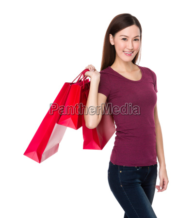asian woman with red shopping bag