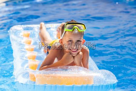 casual boy having fun in swimming