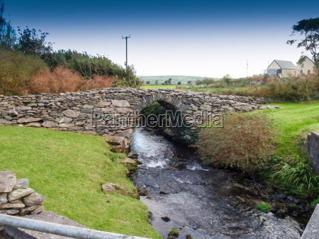 old stone bridge with a rivulet