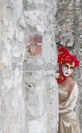woman with red venetian mask and
