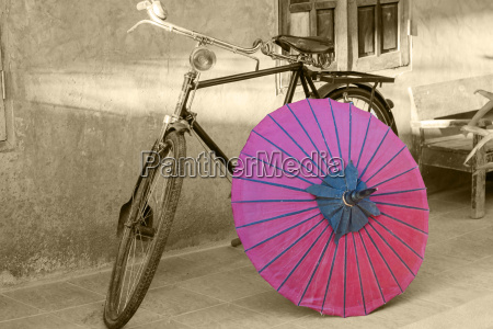 retro bicycle with red umbrella with