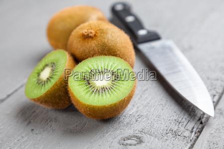 delicious kiwi fruit on grey wooden