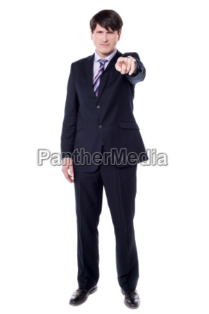 anger businessman pointing to you