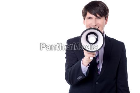 businessman with a loudhailer