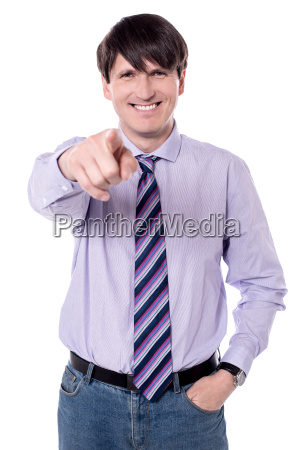 smiling businessman pointing at you