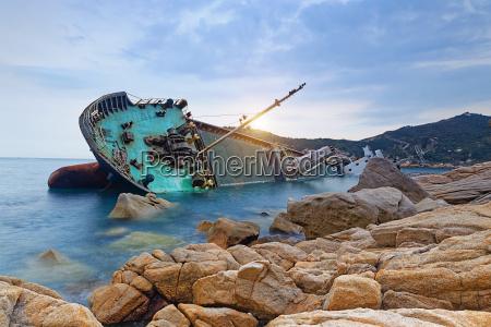 shipwreck or wrecked cargo ship abandoned