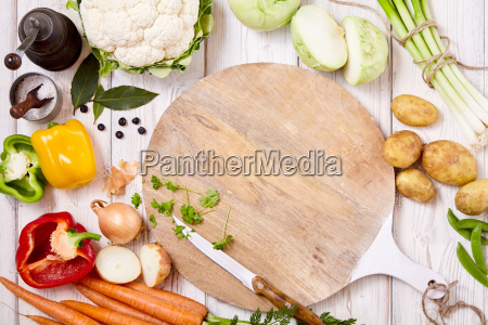 knife cutting board and fresh vegetables