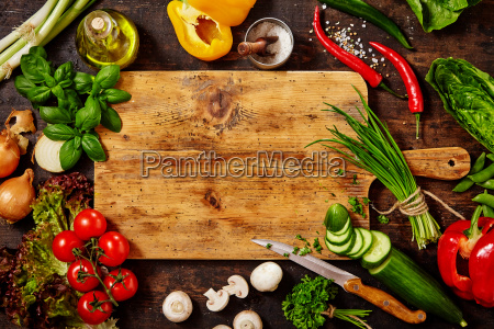 cutting board and knife with vegetables