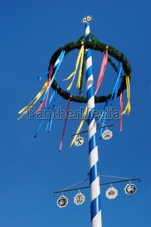 bavarian maypole against blue sky