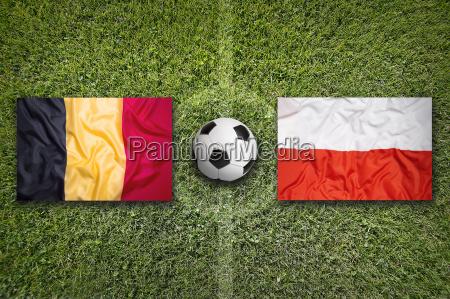 belgium vs poland flags on soccer