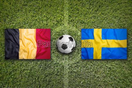 belgium vs sweden flags on soccer