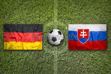 germany vs slovakia flags on soccer
