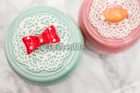 colorful ceramic round jars with lace