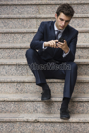 portrait of young businessman sitting on