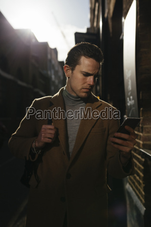 man looking on cell phone in