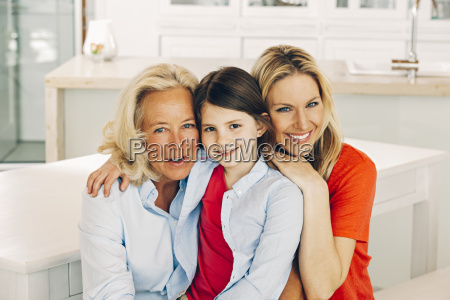 portrait of smiling grandmother mother and