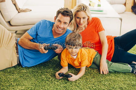 family of three playing video game