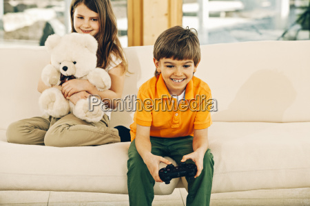 boy playing video game in living