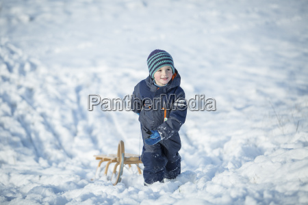 little boy with sledge