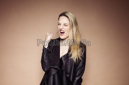 portrait of screaming blond woman