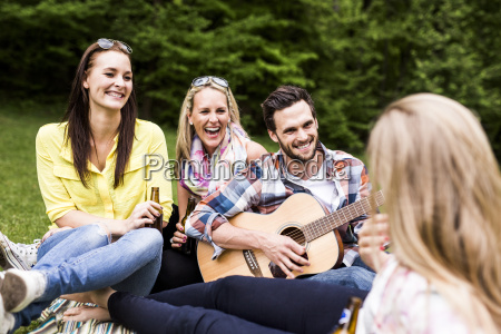happy friends with guitar and beer