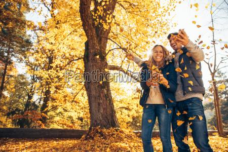 happy couple having fun in autumn
