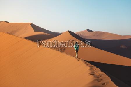 namibia namib desert sossusvlei woman walking