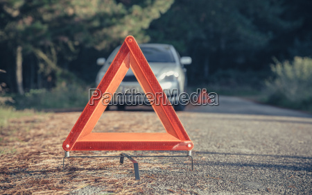 warning triangle in the road by