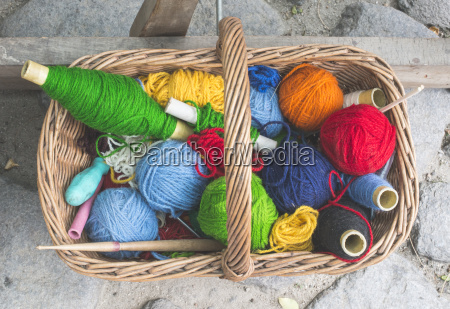balls of yarn in vintage basket