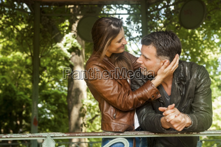 affectionate couple in gazebo at park
