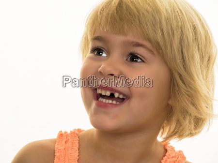 portrait of smiling girl with tooth