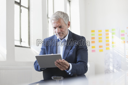 businessman in office using digital tablet
