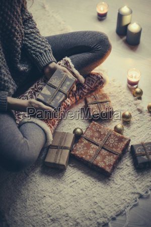woman sitting with christmas presents on