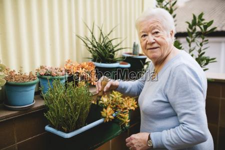 portrait of senior woman gardening on