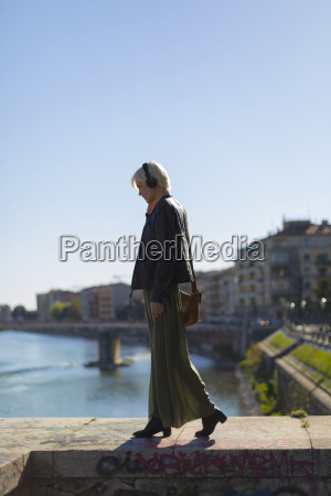 italy verona fashionable blond woman walking