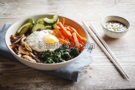 vegetarian korean rice bowl with mushroom