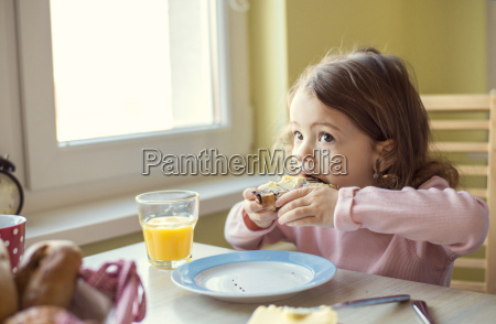 portrait of little girl eating a