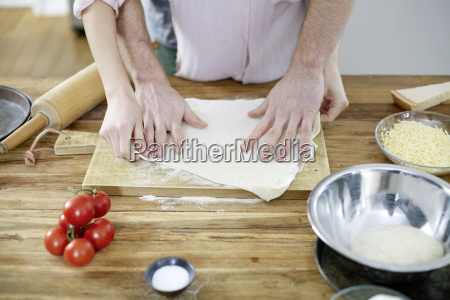couple preparing dough together