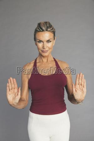 mature woman flexibility exercise arm ellbow