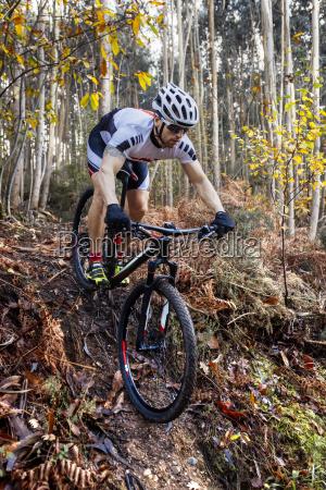 mountain biker driving downhill in a