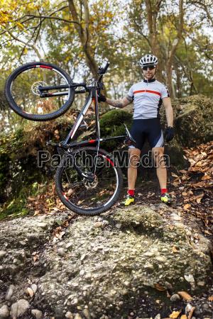 mountain biker with his bike in