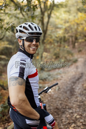 portrait of smiling mountain biker withcycling