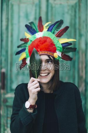 portrait of woman wearing indian headdress