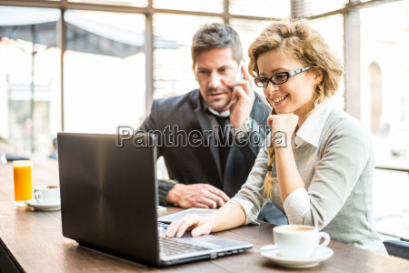 two business partners sitting in a