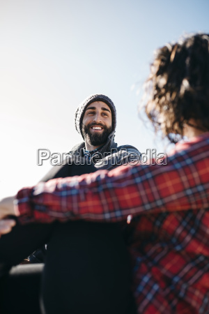 happy young man looking at girlfriend