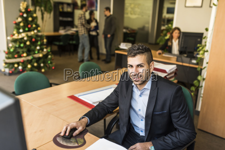 portrait of smiling man working at