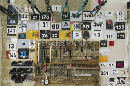 numbers and tools hanging at the