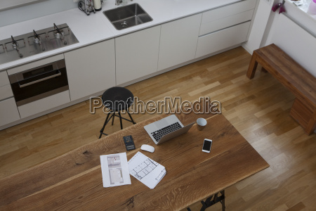 construction plan laptop calculator and cell