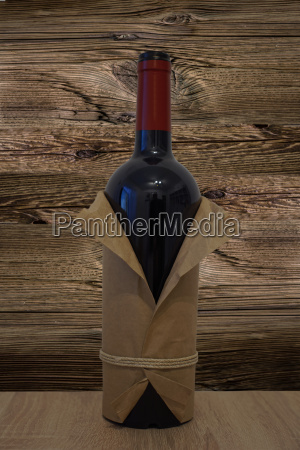 bottle of red wine in wrapping
